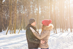Happy Young Couple in Winter Park having fun. Family Outdoors. love Royalty Free Stock Images