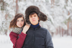 Happy Young Couple in Winter Park having fun.Family Outdoors. love, valentine day Royalty Free Stock Photo
