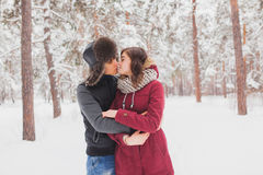 Happy Young Couple in Winter Park having fun.Family Outdoors. love, valentine day Stock Images