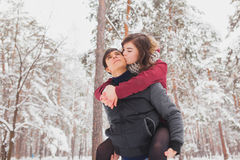 Happy Young Couple in Winter Park having fun.Family Outdoors. love, valentine day Royalty Free Stock Photos