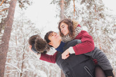 Happy Young Couple in Winter Park having fun.Family Outdoors. love, valentine day Stock Photography