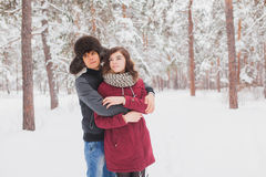 Happy Young Couple in Winter Park having fun.Family Outdoors. love, valentine day Stock Photo