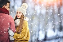 Happy Young Couple in Winter Park laughing and having fun. Family Outdoors. Copycpace. stock image