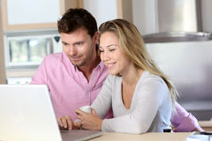 Happy young couple working on laptop Royalty Free Stock Photography