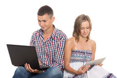 Happy young couple working on PC Stock Photos