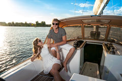 Happy young couple on a yacht Royalty Free Stock Photo
