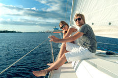 Happy young couple on a yacht Stock Photos