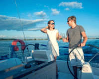 Happy young couple on a yacht Royalty Free Stock Images
