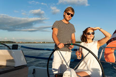Happy young couple on a yacht Stock Image