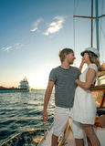 Happy young couple on a yacht Stock Photo