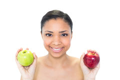 Happy young dark haired model holding apples Royalty Free Stock Images