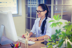 Happy young designer working at desk Stock Photos