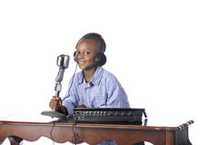 Happy Young DJ. A handsome young African American happily working as a disc jockey.  On a white background Stock Photography