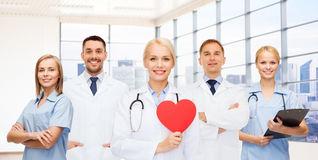 Happy young doctors cardiologists with red heart Royalty Free Stock Photography