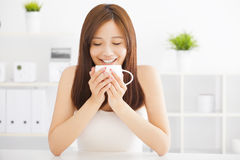Happy young drinking coffee Royalty Free Stock Image