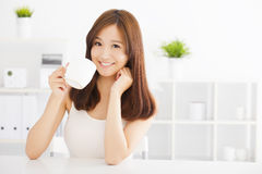 Happy young drinking coffee Stock Image