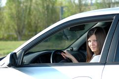 Happy young driver. Portrait of the young woman in car Royalty Free Stock Image