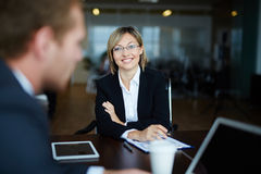 Happy young employer. Young employer hiring manager for work in her company Royalty Free Stock Photo