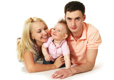 Happy young family. Father, mother and their baby boy Royalty Free Stock Photos