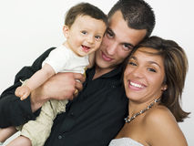 Happy young family. A portrait of a beautiful young family with a little baby Stock Image