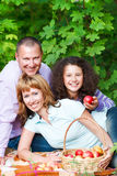 Happy young family on autumn picnic. Happy young family with daughter on autumn picnic Royalty Free Stock Photos