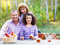 Happy young family on autumn picnic Stock Photo