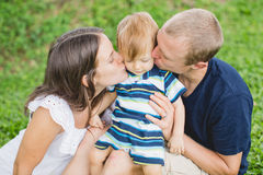 Happy young family with baby boy outdoors Royalty Free Stock Photos