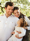 Happy young family with baby girl outdoors Royalty Free Stock Image