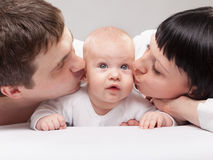 Portrait of a young happy family with the kid Royalty Free Stock Photos