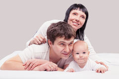 Portrait of a young happy family with the kid Royalty Free Stock Photography