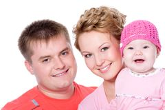 Happy young family with beautiful baby Stock Photos