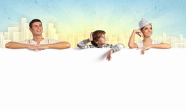 Happy young family with blank banner Royalty Free Stock Photos