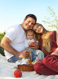 Happy young family with child outdoors Royalty Free Stock Image