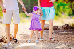 Happy young family with child resting outdoors in summer park Royalty Free Stock Photography