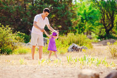 Happy young family with child resting outdoors in summer park Stock Images