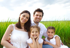 Happy young family with children outdoors Stock Photo