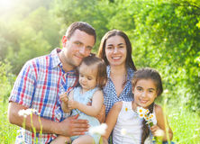 Happy young family with children in the spring forest Stock Photos