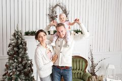 Happy young family in Christmas morning in home. look at the camera. Happy new year Stock Photography