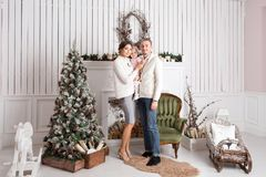 Happy young family in Christmas morning in home. look at the camera. Happy new year Stock Photo