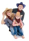 Happy young family in cowboy clothes Royalty Free Stock Photo