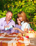 Happy young family with daughter. On autumn picnic Stock Image