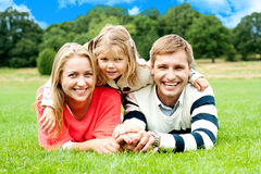 Happy young family with daughter outdoors Royalty Free Stock Image