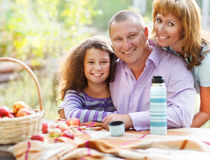 Happy young family with daughter outdoors. Happy young family with daughter on autumn picnic Royalty Free Stock Image