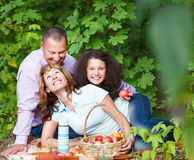 Happy young family with daughter on picnic Stock Photos