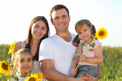 Happy young family with daughters outdoors Royalty Free Stock Image