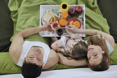 Happy Young Family Eat Breakfast In Bed Royalty Free Stock Image