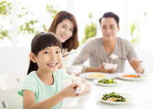 Happy young Family enjoy their  dinner. Happy young asian Family enjoy their  dinner Royalty Free Stock Photos