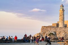 Happy young family dancing in evening sun on Malecon, Havana Stock Image