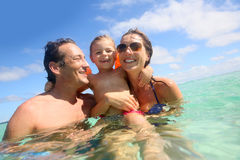 Happy young family enyoing the summer holidays on the seaside Stock Image