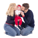 Happy young family - father and mother kissing little daughter i Royalty Free Stock Photography